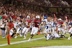 Stanford football player scoring a touchdonwn.