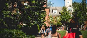 High School students walk down the brown university board walk