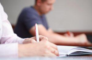 High school students writing Harvard supplemental essays.