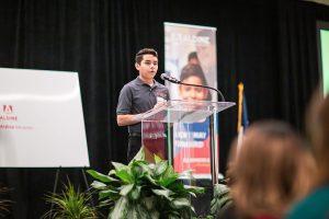 High school student delivers his speech