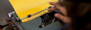 Typewriter and yellow paper