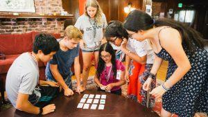 Stanford University Mathematics Camp (SUMaC) participants working on a problem